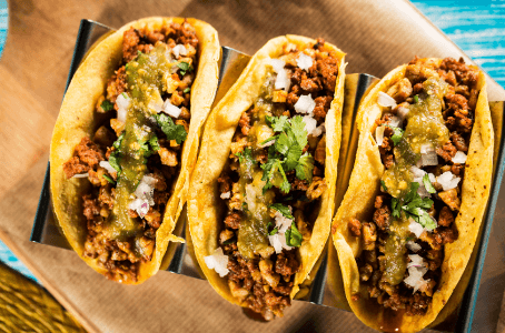 You can put pretty much anything in tacos, but most commonly, the filling consists of carne de rez (a beefsteak)
