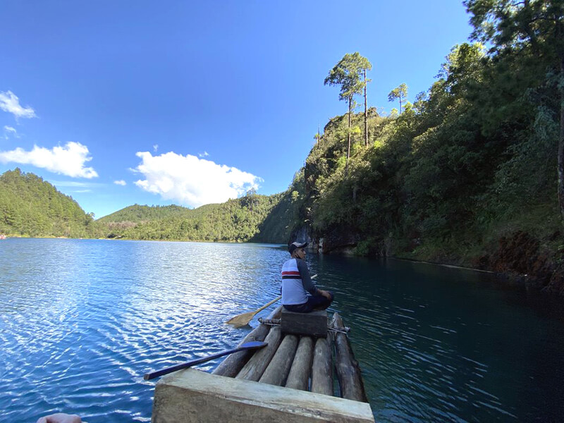 Man paddling a raft as a Chiapas activity