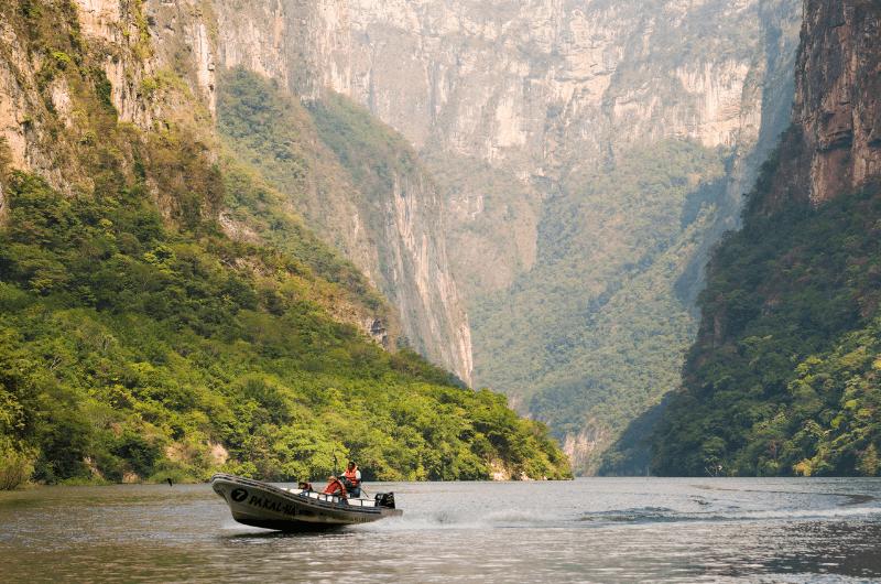 Man taking a boat trip as a Chiapas activity