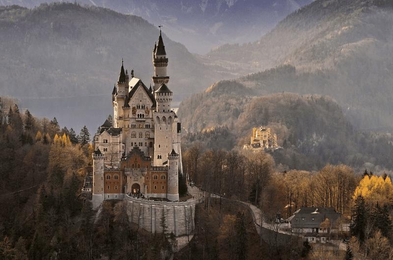Neuschwanstein castle in fall, Hohenschwandau in the background