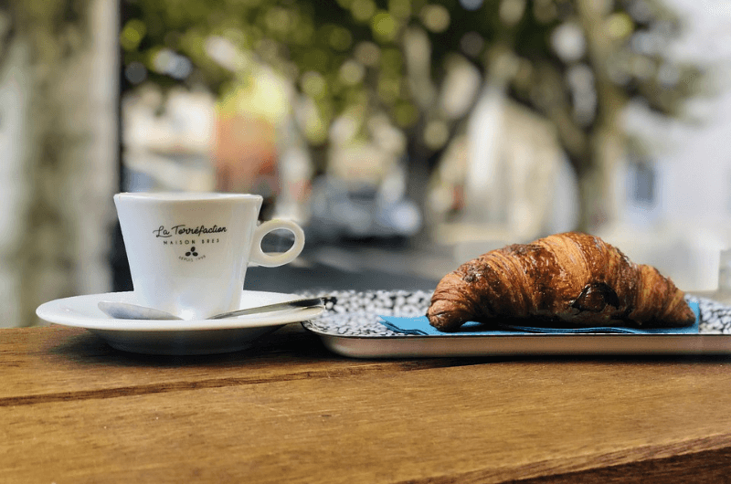 Typical Italian breakfast, espresso and croissant